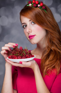 Redhead Girl Eating Berries