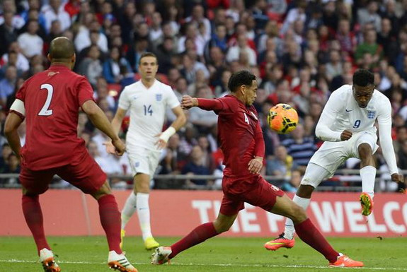 England forward Daniel Sturridge shoots to score his side's opening goal against Peru