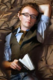 Actor Paul Cram in bed