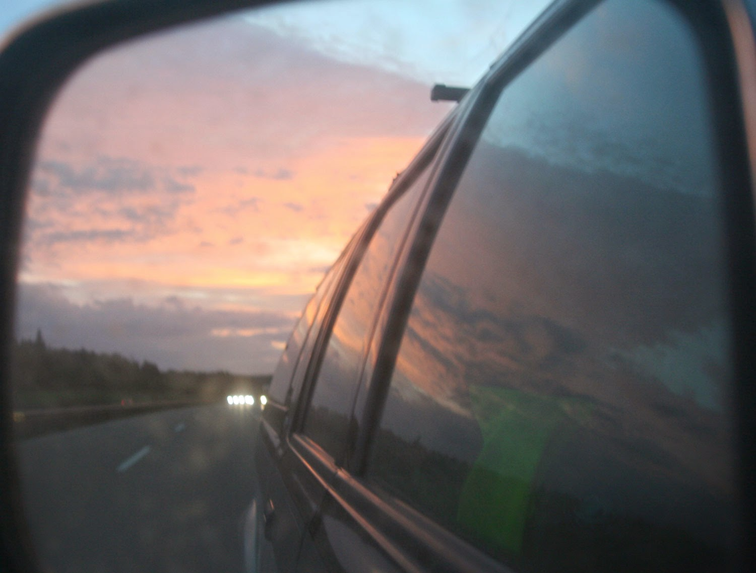 The sunrise as seen in Thomas' wing mirror