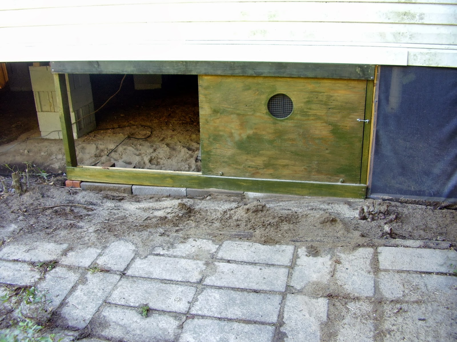 Sliding door for access to crawlspace. Mostly recycled and re-purposed materials -- plywood from the mobile home we disassembled quite a while back ... & Low Rent Renaissance: Some more mobile home skirting efforts