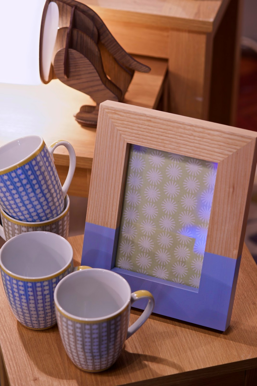 blue accents on mugs and photoframes