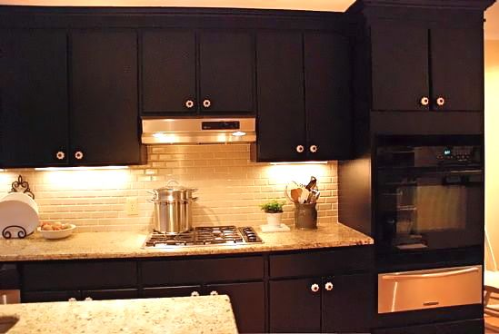 Kitchen trends how to paint kitchen cabinets black for Images of black kitchen cabinets