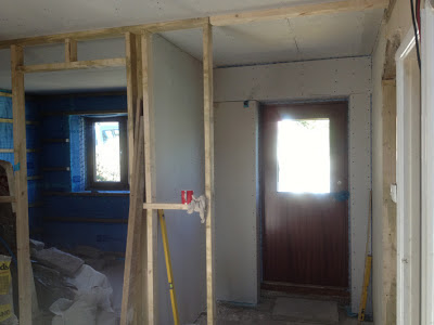 Plasterboard fitted to walls by front door