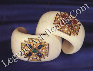 A pair of cocholong cuff bracelets inset with gold, colored stone and diamond Maltese crosses.