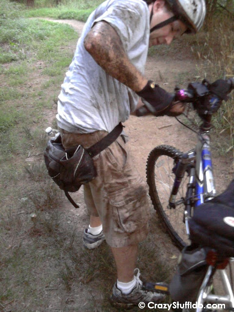 Trying to get my trail bike into a usable state after the accident.  Mud covered, but the only thing bruised was my ego :)