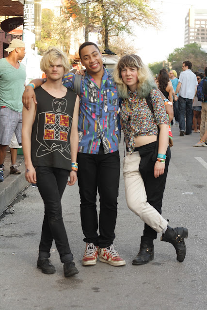 three friends with funky style at sxsw music festival