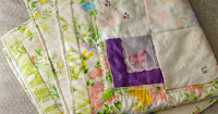 http://www.patchworkposse.com/vintage-hankies-baby-quilt-pattern/