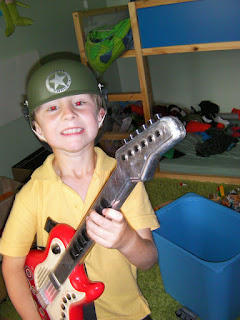 US army guitarist in messy bedroom