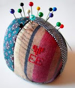 Handstitched pincushions by Ellie Evans
