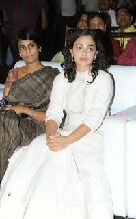 Actress Nithya Menen Pictures in White Long Dress at Malli Malli Idi Rani Roju Audio Launch  37.jpg