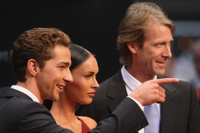 Hot & Sexy Megan Fox in Red Dress with Shia LaBeouf at Transformers - Revenge Of The Fallen Premiere in Germany
