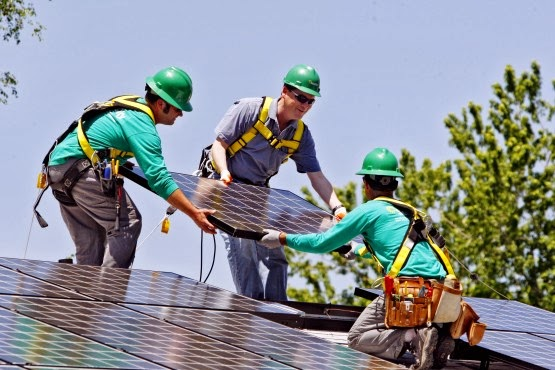 Installing solar panels on a roof (Credit: AP/Ed Andrieski) Click to enlarge.