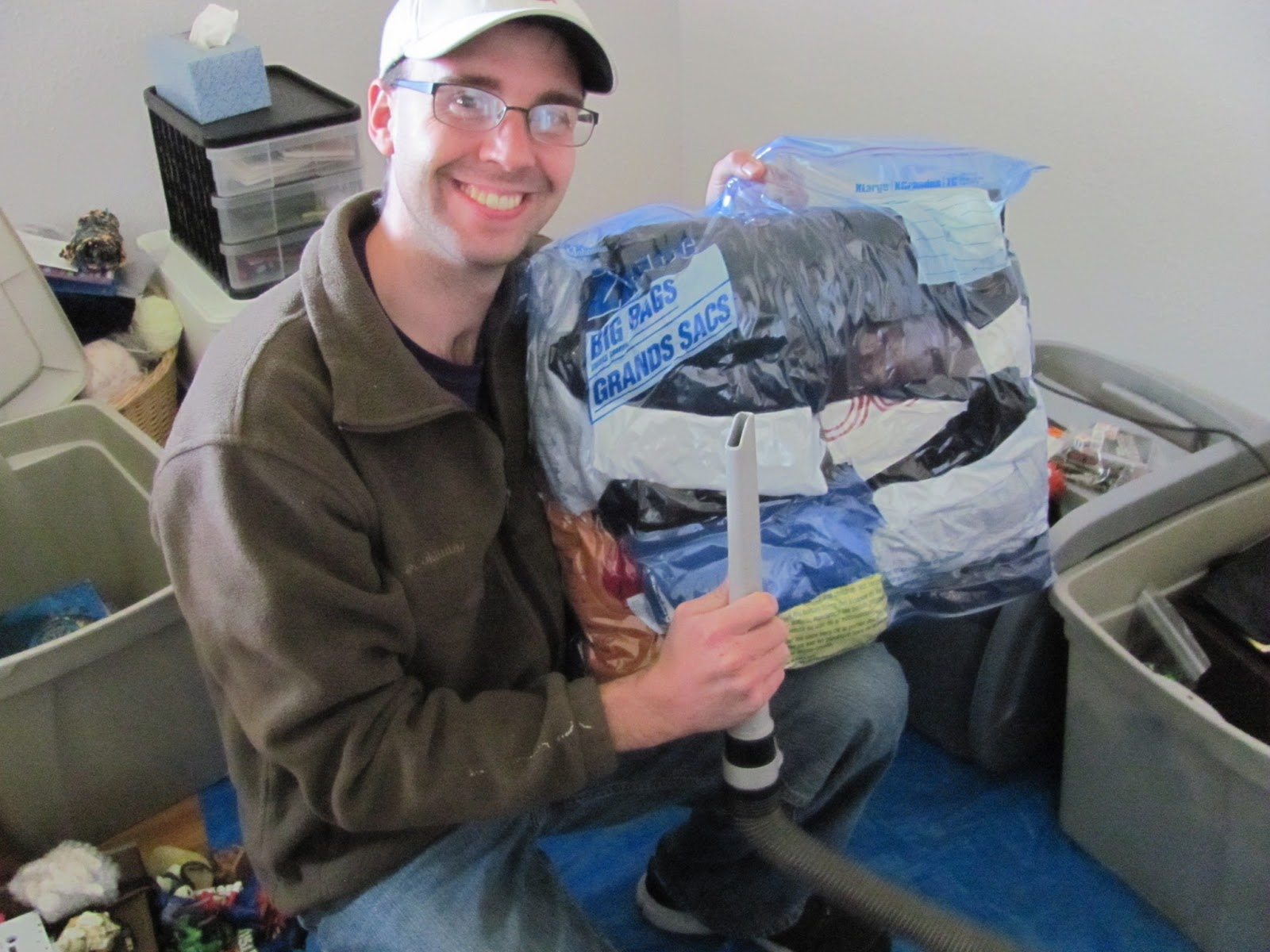 Cory holding a vacuum space-saver bag, freshly flattened