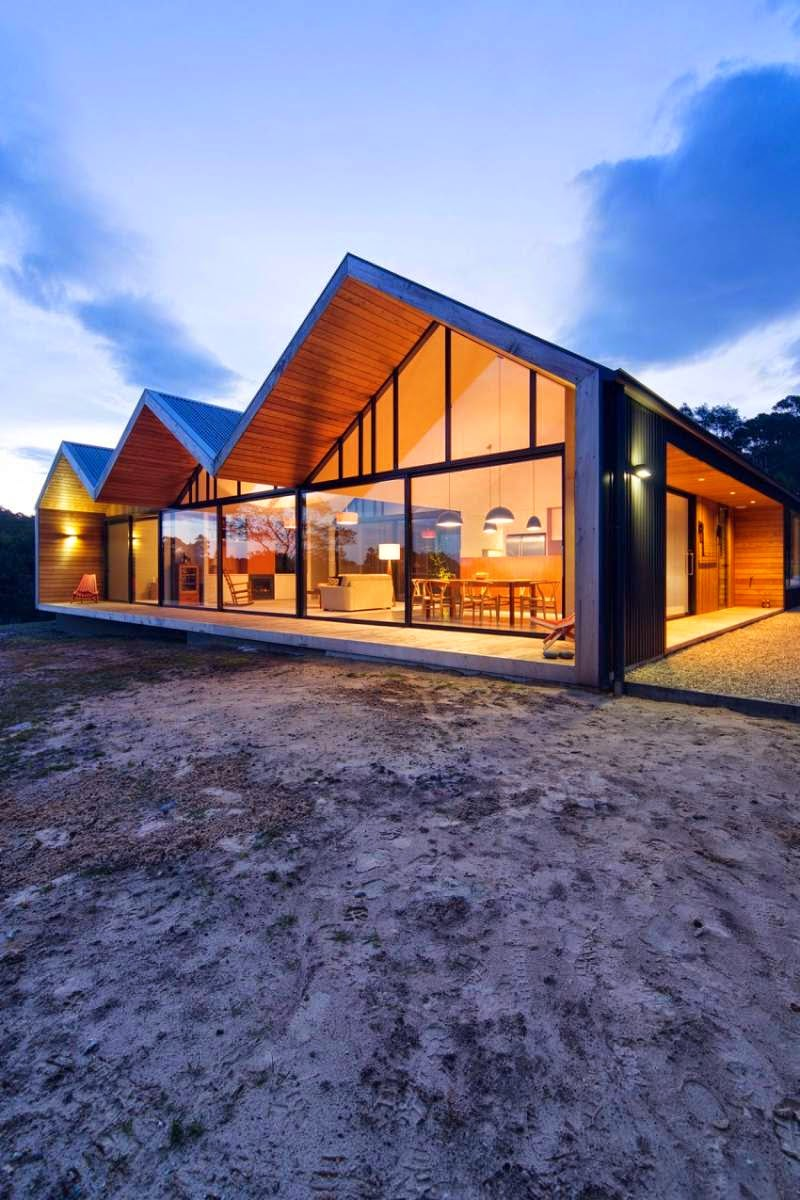 Contemporary house with three gable roofs in tasmania for Gable house plans