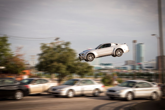 ford mustang in the air - Need for speed movie still
