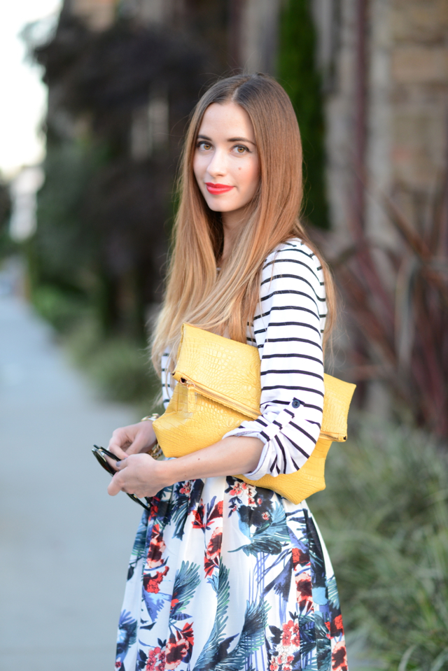 oversized yellow clutch with striped top and floral midi skirt via M Loves M