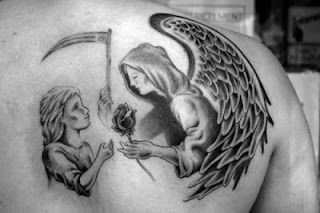 Angel of Death tattoo on the back: the Angel of Death offering a rose to a child