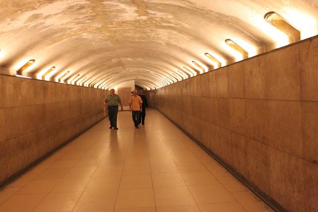 Walk underpass at the end block of building of Avenue des Champs-Elysees  to cross the busy roundabout in Paris, France