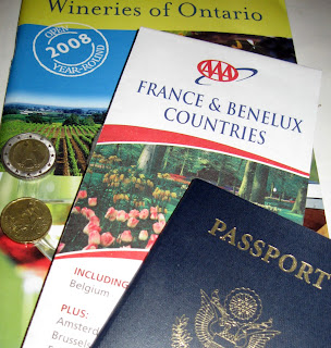 Passport, Euros, France map, and Ontario wineries brochure