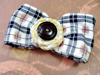 upcycled fabric bow made from shirt sleeves and vintage buttons