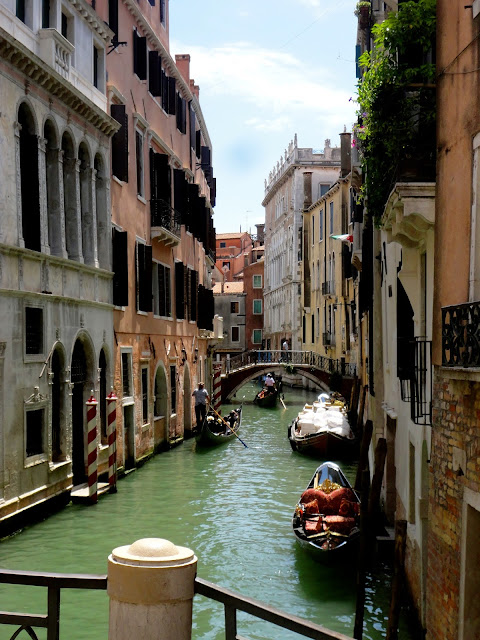 Canal and gondolas in Venice, Italy