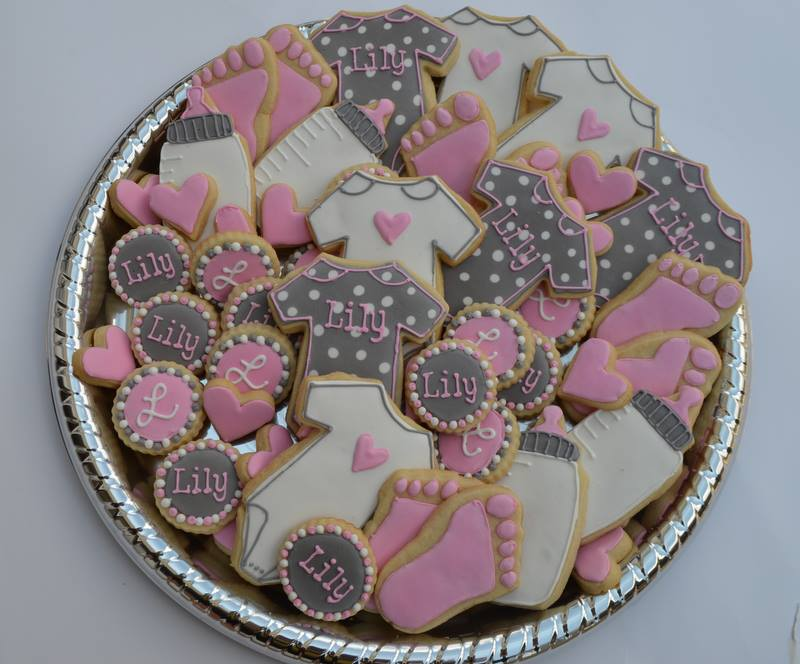 pink and grey baby shower cookies for a soon to be born little girl