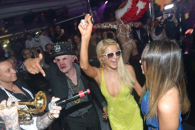 Paris Hilton enjoying some trumpet music at a nightclub in Cannes