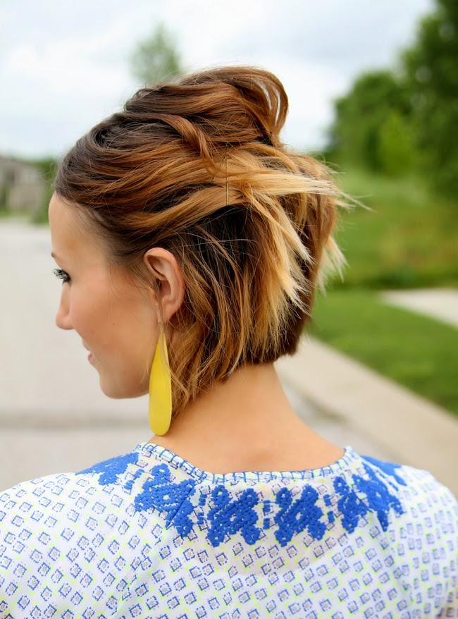 Short, wavy ombre hair pinned back