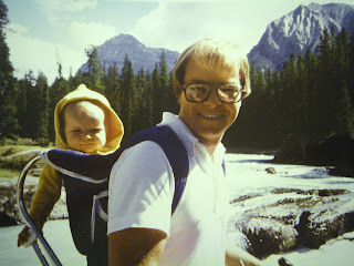 Dad hiking with baby in Mountains