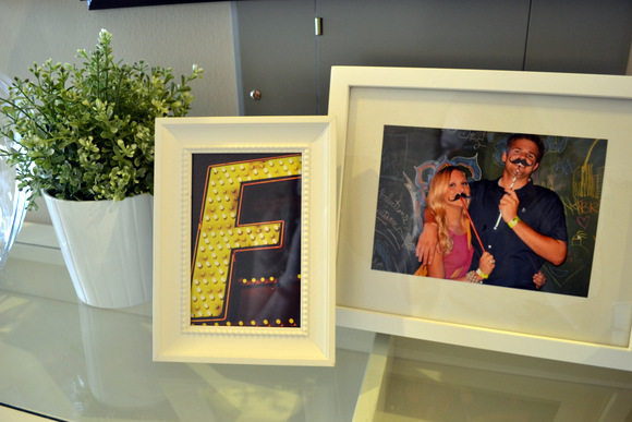 White Frames with picture and F monogram: Design Your Entryway | DIY Playbook