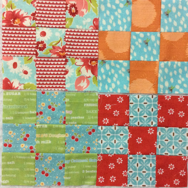 photo of four scrappy nine patch blocks