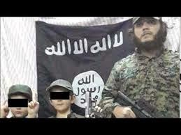 http://news.sky.com/story/1316641/oz-jihadists-son-9-poses-with-severed-head