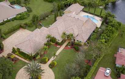 Recently sold by Marilyn: PARKLAND: 6 bedroom estate on lake in Cypress Head, a gated community