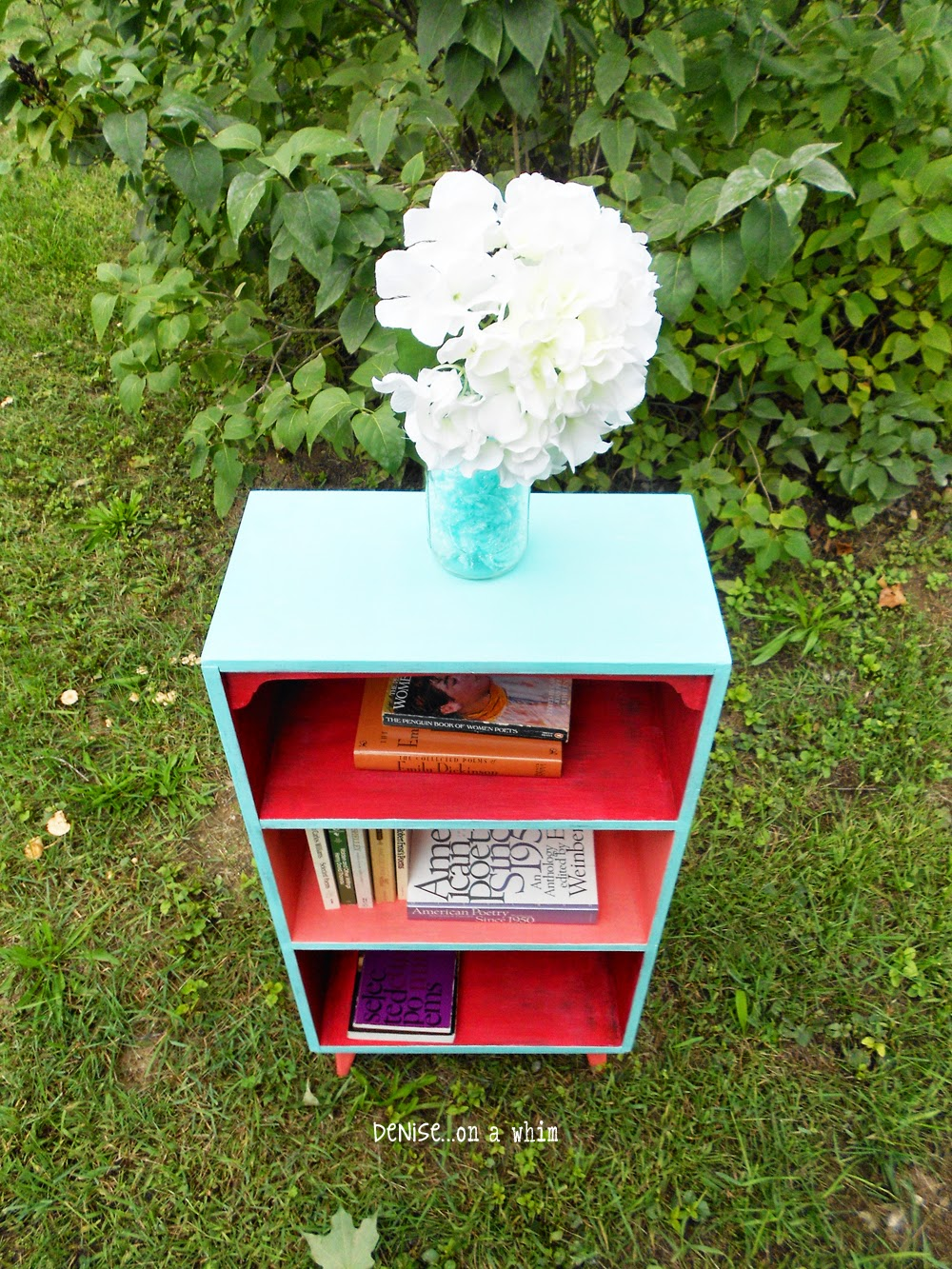 Pretty Turquoise with Coral and Red on a Bookcase Makeover from Denise on a Whim
