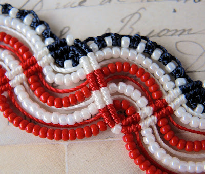 Close up of micro macrame flag bracelet by Sherri Stokey