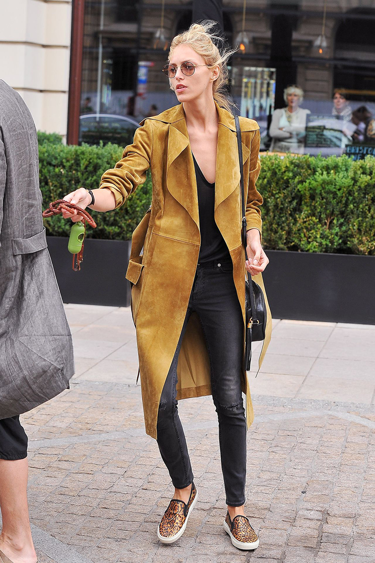 Anja Rubik street style, model off duty, Saint Laurent suede trench coat, leopard print slip-on sneakers
