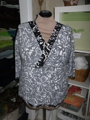 The back neckline has a self-fabric turned-down binding as a facing.