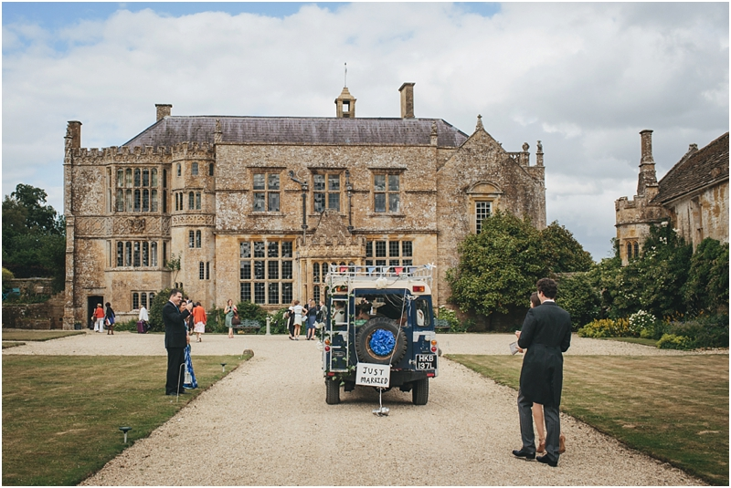 Bride and groom driving up to Brympton House