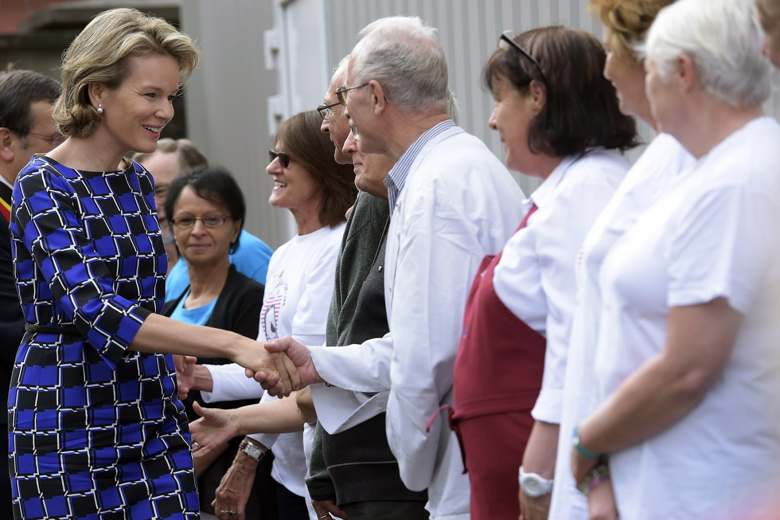 Queen Mathilde also had time to attend to some of the many people who had turned up to catch a glimpse of the Queen.