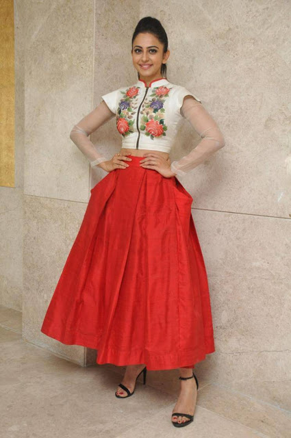 Rakul Preet Singh in Bright Red Plain Silk Lehenga at Nannaku Prematho Movie Press Meet Event
