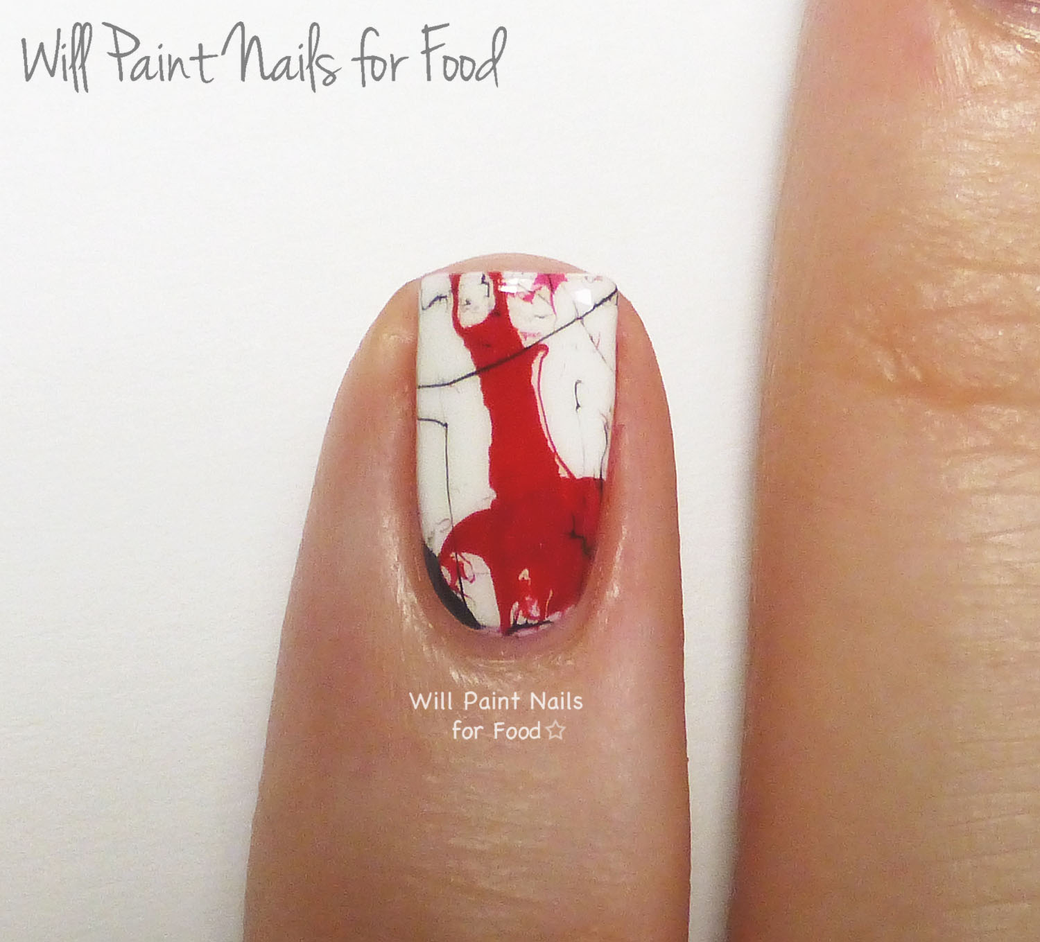 Red marble nail art (detail)
