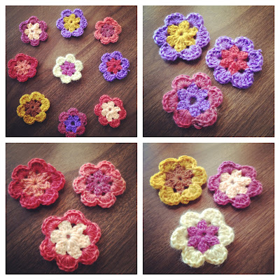 4 photos of colorful 2-tone crocheted flowers. 1 photo shows all 9 flowers laying on a dark wooden  surface. 1 photo shows the 3 flowers that have mostly red-pink coloring for their petals or centers. 1 photos shows the 3 flowers that have mostly bright purple for their petals or centers. And 1 photo shows the 3 flowers that have mostly yellow for their petals or centers.