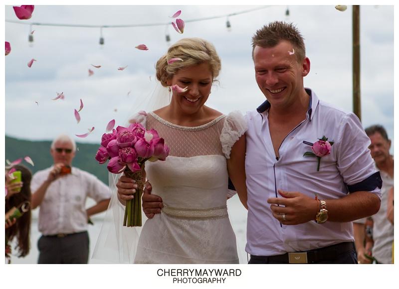 bride and groom walking back up the aisle, Ama Lur, The Palace wedding, Koh Samui, Thailand, destination wedding