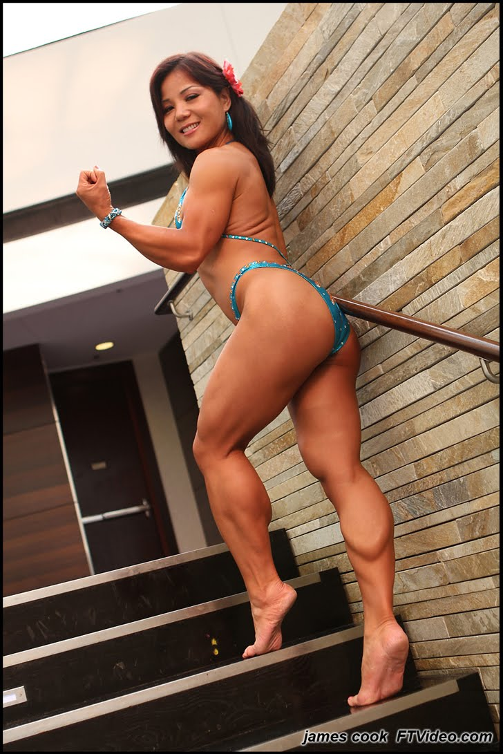 Michelle Jin Flexing Her Massive Calves And Bicep In A Bikini