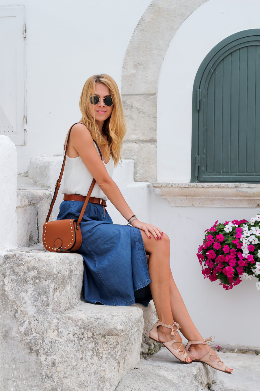 midi denim skirt with white blouse, lace-up flats and tan accessories