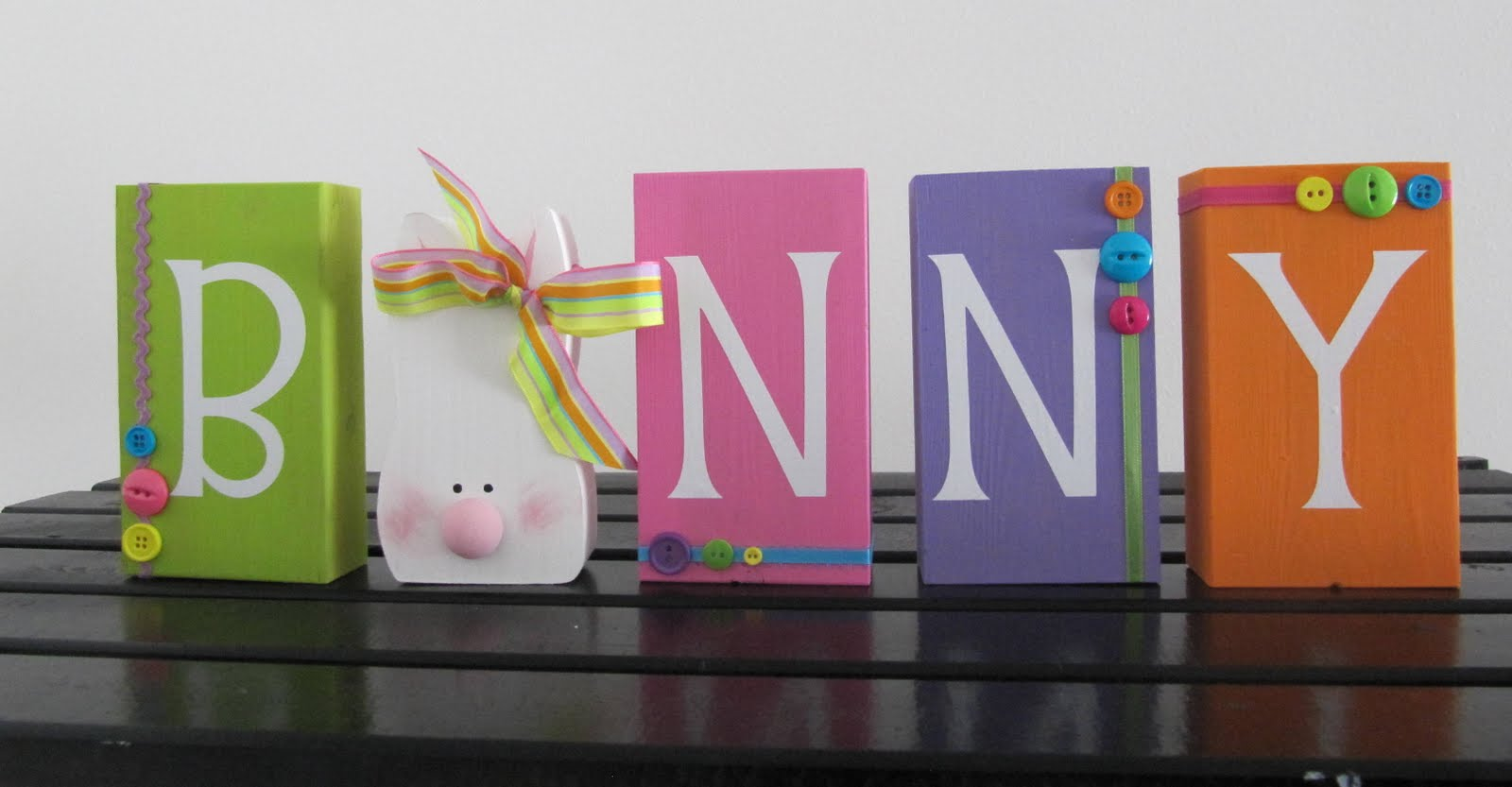 Recipes crafts and more easter crafts white vinyl letters cut out on my cri cut ribbon buttons and some bright spring colors of paint and you have yourself some bunny easter decor solutioingenieria Choice Image