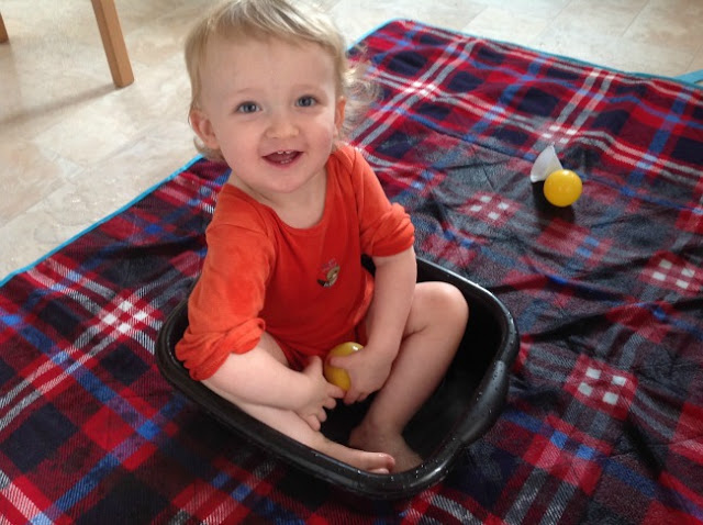 My Sunday Photo. Toddler sat in washing up bowl full of water