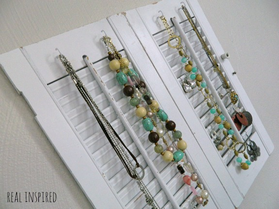 A tutorial for a DIY jewelry organizer made from old shutters!