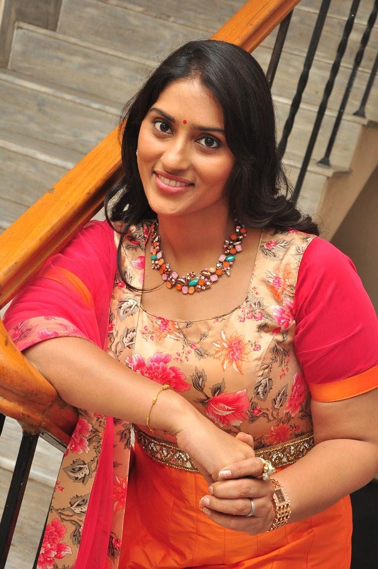 Sri Sudha in a lovely orange Anarkali Dress